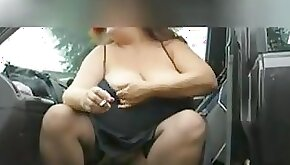 Fat amateur woman smokes and plays with her pussy in her car
