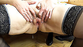 Chubby redhead granny is in heaven while getting banged by a young guy
