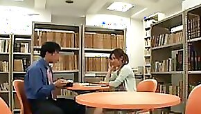 Naughty Japanese Voyeur Gives Footjob To a Guy In a Public Library