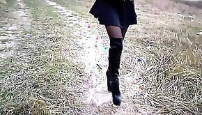 High boots short dress legs in pantyhose and strong wind