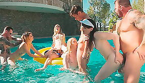 Trannies and guys have a pool party orgy
