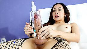 Asian shemale using a penis pump