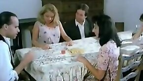 Hairy pussy fingering under the table in this vintage video