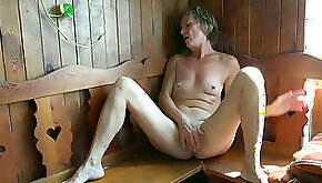 Mature white with her shaved pussy in solo action