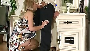 Half naked mature smoker serves a young cock on her knees