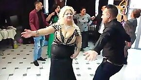 A woman playing with a huge bust dancing