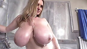 Busty milf in the bath. Big natural tits.